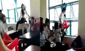 Lớp trưởng đánh bạn dã man vì không chịu phục tùng