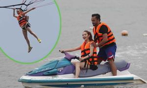 Minh Hằng tập lái cano, bay dù lượn trên biển