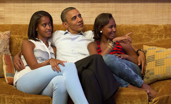 President Barack Obama and his daughters Malia and Sasha, watch on television as first lady Michelle Obama takes the stage to deliver her speech at the Democratic National Convention, in the Treaty Room of the White House in Washington September 4, 2012.