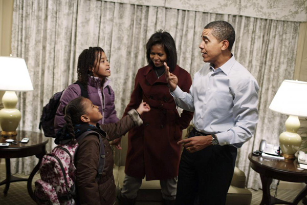 Then President-elect Barack Obama and Michelle Obama get their daughters Sasha (L) and Malia (second from left) ready for their first day of school at Sidwell Friends in Washington January 5, 2009.