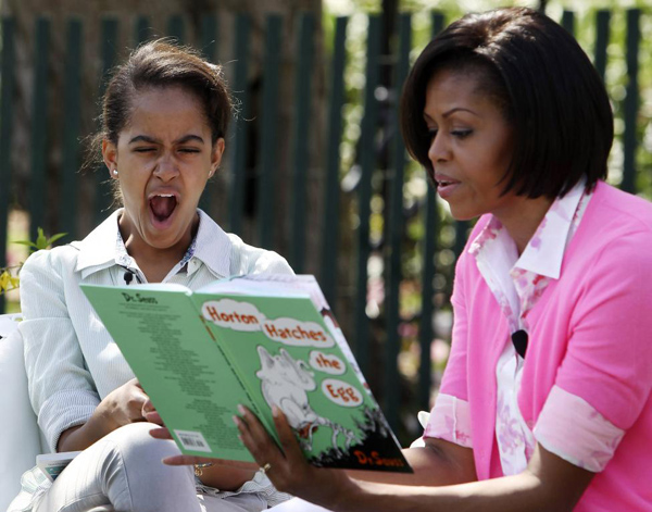 Malia Obama yawns as she listens to her mother first lady Michelle Obama read a Dr. Seuss book at the annual Easter Egg Roll on the South Lawn of the White House in Washington April 5, 2010.