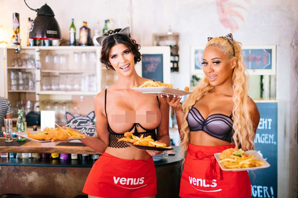 German actress Micaela Schafer, 32, and Playboy model Sarah Joelle, 26, served the punters in scantily clad outfits.