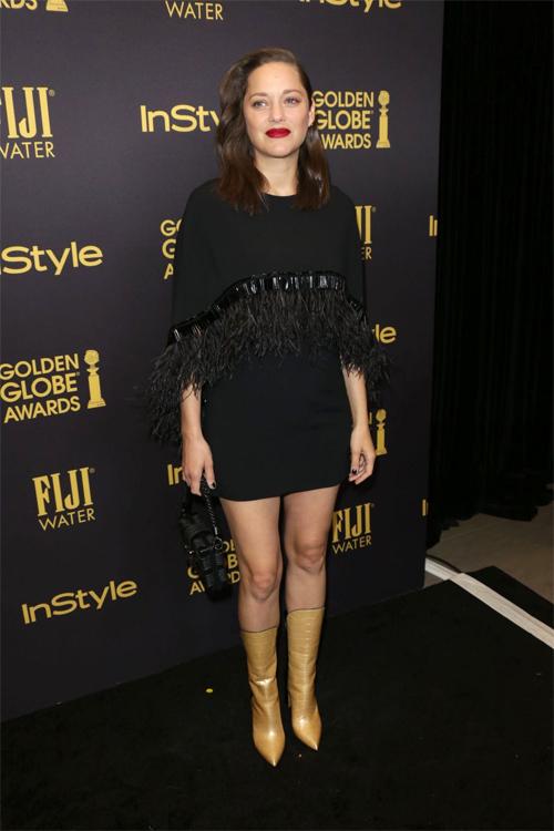 Marion Cotillard với bụng bầu lộ rõ khi dự sự kiện hôm 11/11 tại Los Angeles.