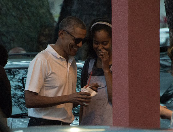 President Barack Obama was joined by his two daughters for a fun filled Saturday during their Hawaiian vacation that included the trio enjoying some shaved ice together after spending the day at an escape room.