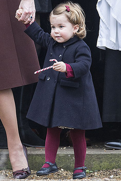 One-year-old Princess Charlotte (left) and three-year-old Prince George (right) both enjoyed a candy cane after church