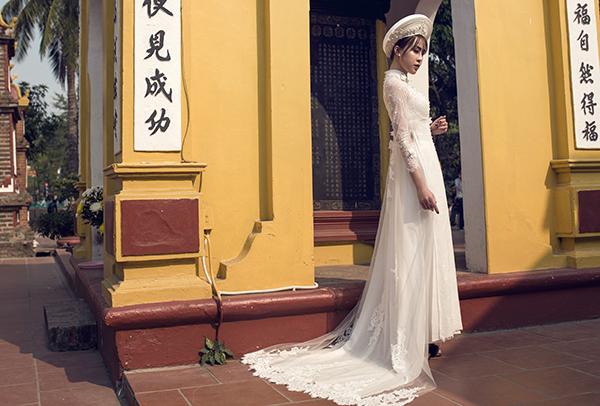 [Caption]Màu trắng thể hiện sự tinh khiết, trang nhã và gợi nét dịu dàng cho tân nương.