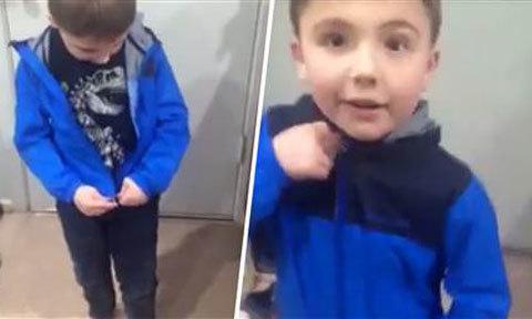 Cậu bé tự kỷ gây xúc động khi tự cài được khóa áo