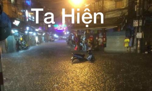 Trung tâm Hà Nội biến thành sông sau cơn mưa ngắn buổi chiều