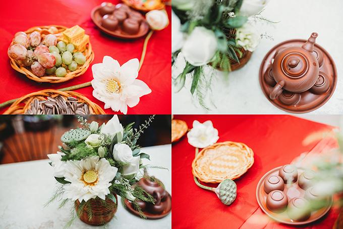 Là người kỹ tính, cô dâu Nhật Hạnh chăm chút cẩn thận cho từng chi tiết nhỏ nhất của buổi lễ như bộ ấm trà gốm Bát Tràng tráng men xanh, bình cắm hoa làm từ giọ bắt cá, đĩa đựng bánh kẹo làm bằng mây tre đan truyền thống&