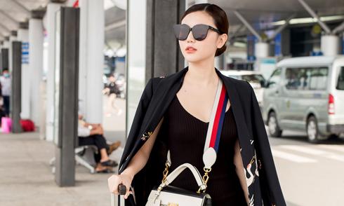 Ngọc Duyên mặc thanh lịch, đeo túi hiệu ra sân bay