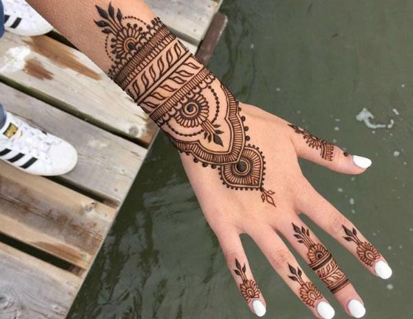 be-trai-7-tuoi-bong-rop-bap-tay-sau-khi-ve-henna-1