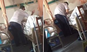 Cha già nằm trên giường bệnh bị con trai đánh tát tới tấp