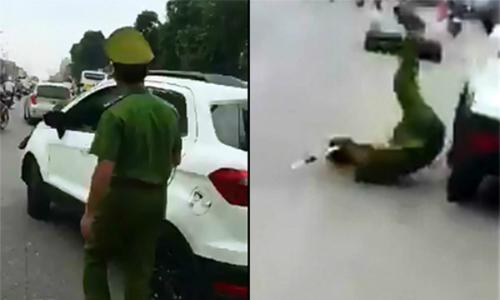 Tài xế ôtô bỏ chạy sau khi tông hất văng cảnh sát