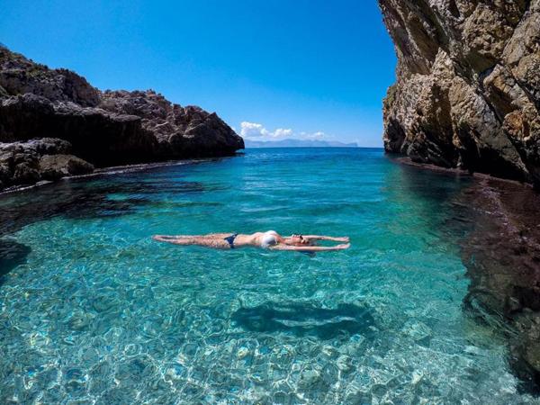 Lindy in a bikini soaking up the sun in Greek waters