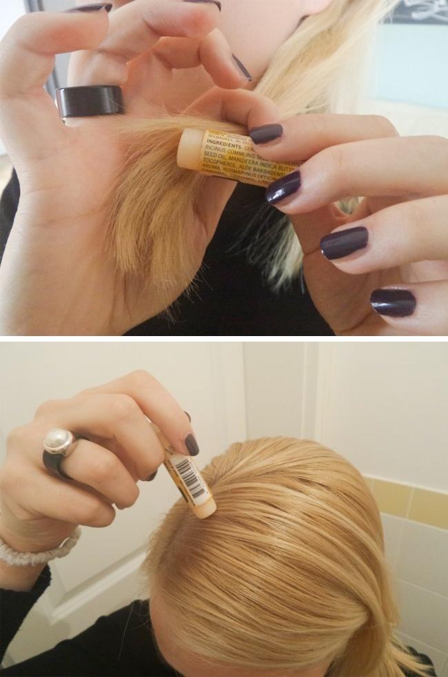 Với những lọn tóc bất trị, hãy dùng son dưỡng môi để khiến chúng vào nếp.