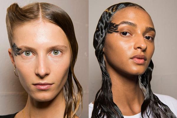 Yohji Yamamoto đưa người mẫu lên sàn diễn với kiểu tóc bên cụp bên xòe.