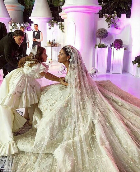 Ganya looked every bit the fairy talebride in her hand-embroidered veil as she greeted guests at her wedding reception