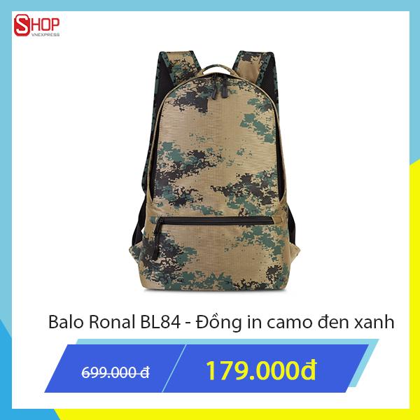 Ba lô Ronal màu đồng in camo đen xanh với chất liệu cao cấp, mang tới phong cách nổi bật cho người dùng. Sản phẩm được giảm giá độc quyền trên Shop VnExpress chỉ còn 179.000 đồng.