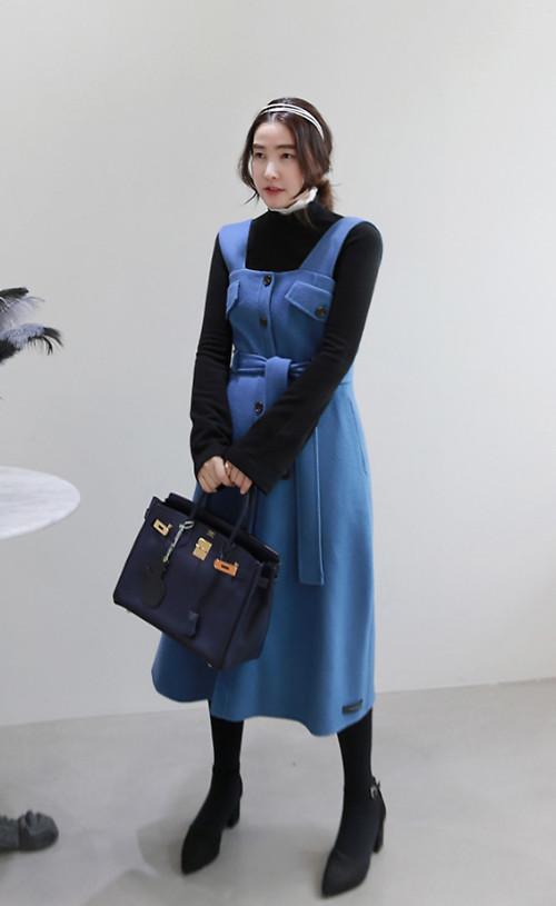 Gam xanh dịu mắt được phối hợp nhịp nhàng cùng các kiểu áo len, váy ka ki, quần vải dạ trên các tông màu đen và xám ghi.