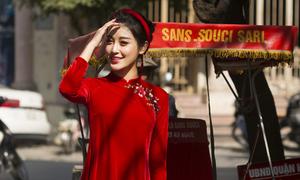 Huyền My dạo phố Hà Nội với áo dài tự thiết kế