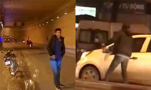 Người đàn ông chặn đầu, cầm gạch đập vỡ kính ôtô trên phố