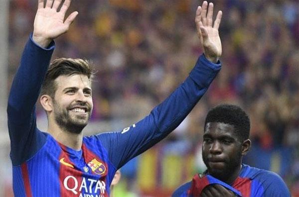 Pique và Umtiti trong màu áo Barca. Ảnh: NS.
