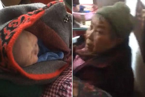 Đứa bé được cụ bà tìm thấy và ủ ấm. Ảnh: Yunnan Daily