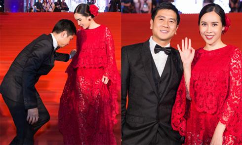 Hồ Hoài Anh khom người chỉnh váy cho vợ trên thảm đỏ