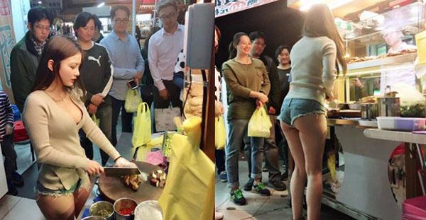 Khách hàng xếp hàng để được mua thịt ở quán do cô gái xinh đẹp phục vụ. Ảnh: Shanghaiist