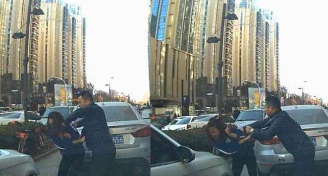 Người đàn ông đánh nữ tài xế họ Liang rồi bỏ chạy.
