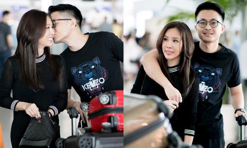 Hoa hậu Thu Hoài quấn quýt bên bạn trai kém tuổi ở sân bay