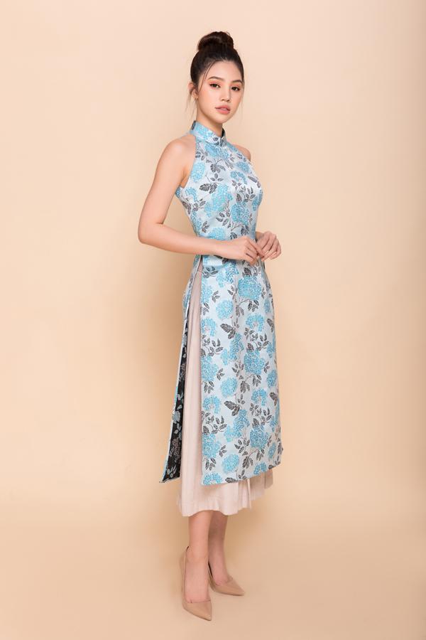 Thay vì các mẫu áo dài truyền thống kín cổng, cao tường, nữ thiết kế gợi ý cùng phái đẹp các mẫu áo cách tân với các chi tiết tay lửng, sát nách kết hợp cùng quần skinny, quần lửng ống rộng.