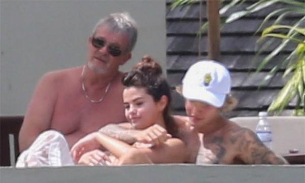 Cặp sao tình tứ bên nhau, tận hưởng nắng ấm nhiệt đới trong ngày vui của gia đình.
