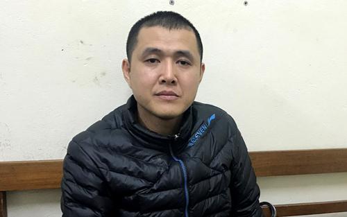 Nguyễn Thành Quang tại cơ quan điều tra. Ảnh:Công an cung cấp.