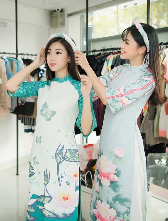 Mỹ Linh và Thanh Tú còn vui vẻ thử nhiều mẫu áo dài duyên dáng khác.