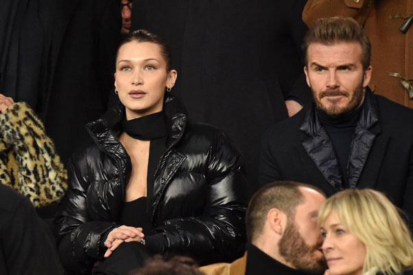 Becks chăm chú theo dõi trận đấu, gương mặt căng thẳng khi ngồi bên cạnh chân dài Mỹ, Bella Hadid.