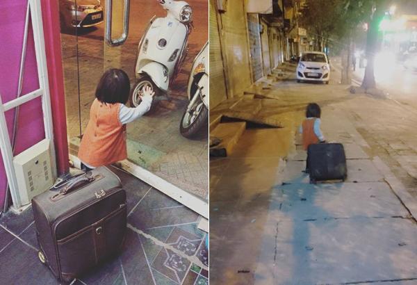 Bé 2 tuổi kéo vali bỏ nhà đi