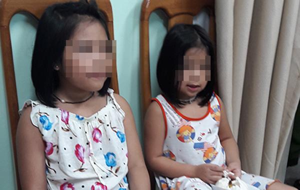 Hai bé gái sau khi được giải cứu. Ảnh: Công an cung cấp.
