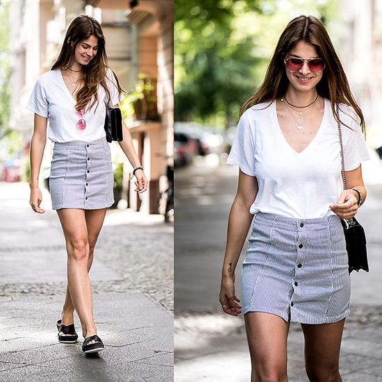 Chân váy cài nút, áo trắng cổ tim, sandal, túi đeo chéo và kính tròng màu trong là các món đồ giúp bạn gái trở nên nhẹ nhàng hơn khi xuống phố cuối tuần.