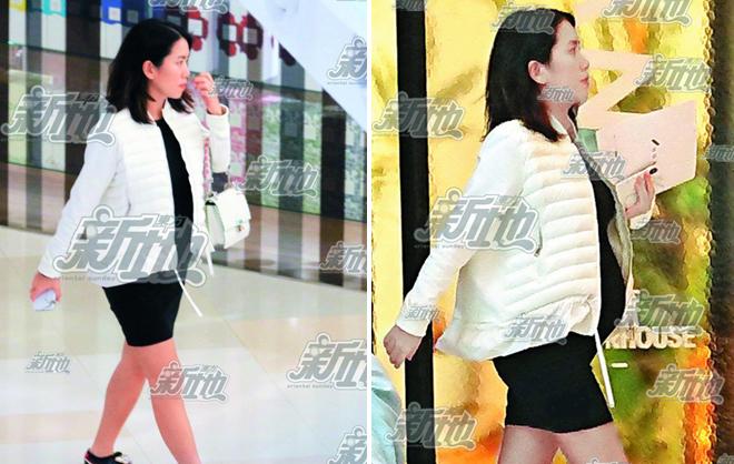 Người yêu của Lê Minh bế bụng bầu đi mua sắm hôm 15/3.