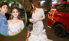 Chồng trẻ cúi người chỉnh váy cho Lâm Khánh Chi khi đi sự kiện