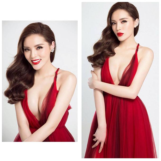 Kỳ Duyên diện chiếc đầm đỏ, khoét sâu, khoe trọn bộ ngực đầy trong bộ sưu tập mới của nhà thiết kế Đỗ Mạnh Cường.