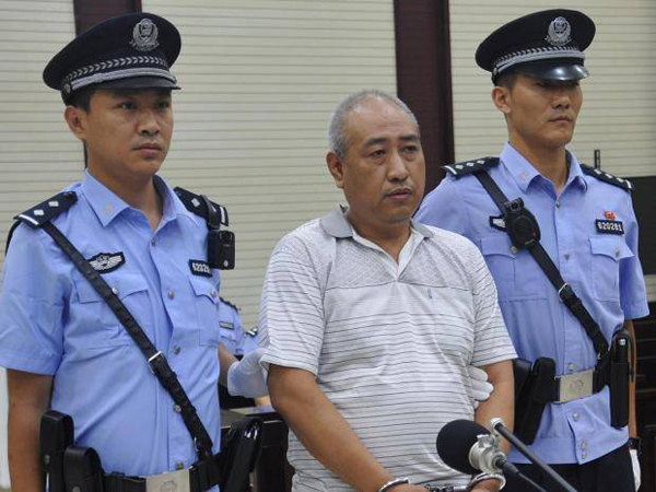 Gao Chengyong tại phiên tòa. Ảnh: Reuters