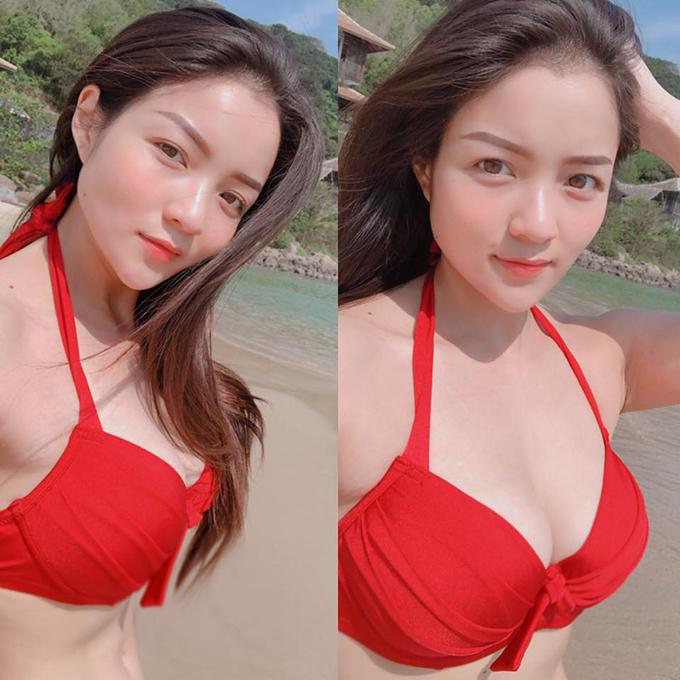 Thuỷ Top tiếp tục đốt mắt người xem với bộ bikini hai mảnh màu đỏ nổi bật. Cô vừa được tiếp thêm năng lượng vitaman sea trong chuyến du lịch Đà Nẵng mới đây.