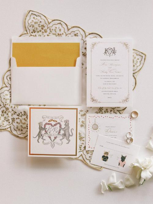 Tấm thiệp cưới độc nhất vô nhịdo chính chú rể vẽ minh hoạđược lấy cảm hứng từ đôi mèo cưng Mo và Tarzan của hai vợ chồng.