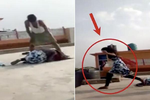 Cô bé không chút do dự nhảy xuống đất trong lúc bị bố dùng dép đánh lên đầu. Ảnh: LiveLeak