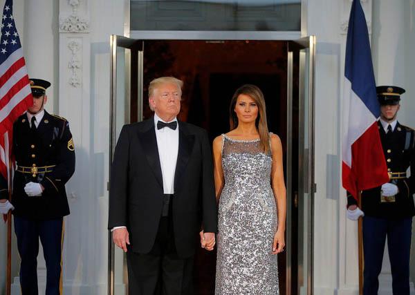 Vợ chồng Tổng thống Mỹ Donald Trump. Ảnh: Reuters.