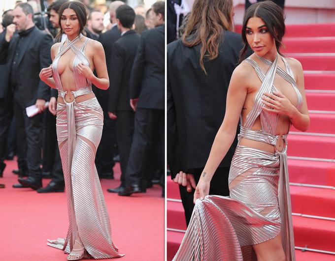 Bồ cũ của Justin Bieber - người mẫu Mỹ Chantel Jeffries - diện bộ đầm hở tứ bề. Cô liên tục lấy tay chỉnh váy vì sợ lộ hàng.