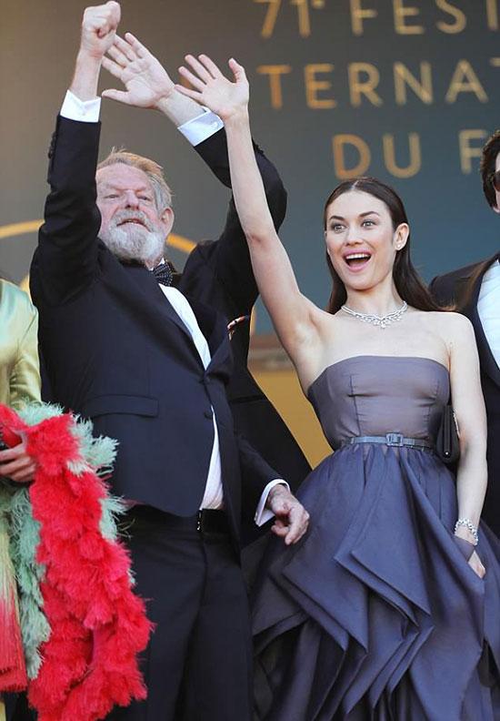 Olga tự hào khi bộ phim mới được trình chiếu tại Cannes. Phim The Man Who Killed Don Quixote do đạo diễn Terry Gilliam thực hiện (bên trái), với sự góp mặt của nhiều ngôi sao như Adam Driver, Jonathan Pryce, Stellan Skarsgård...