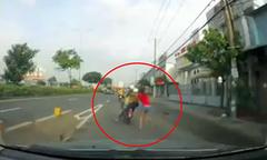 Giằng co với kẻ trộm, cô gái bị kéo lê trên quốc lộ